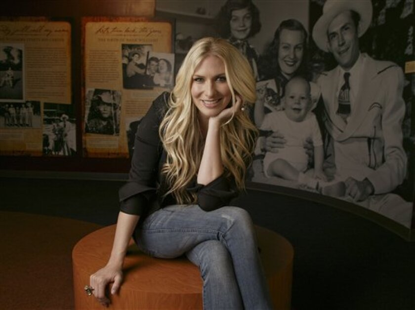 Holly Williams, daughter of Hank Williams Jr.,  is shown in the Williams family exhibit at the Country Music Hall of Fame and Museum in Nashville, Tenn., June 2, 2009. (AP Photo/Ed Rode)