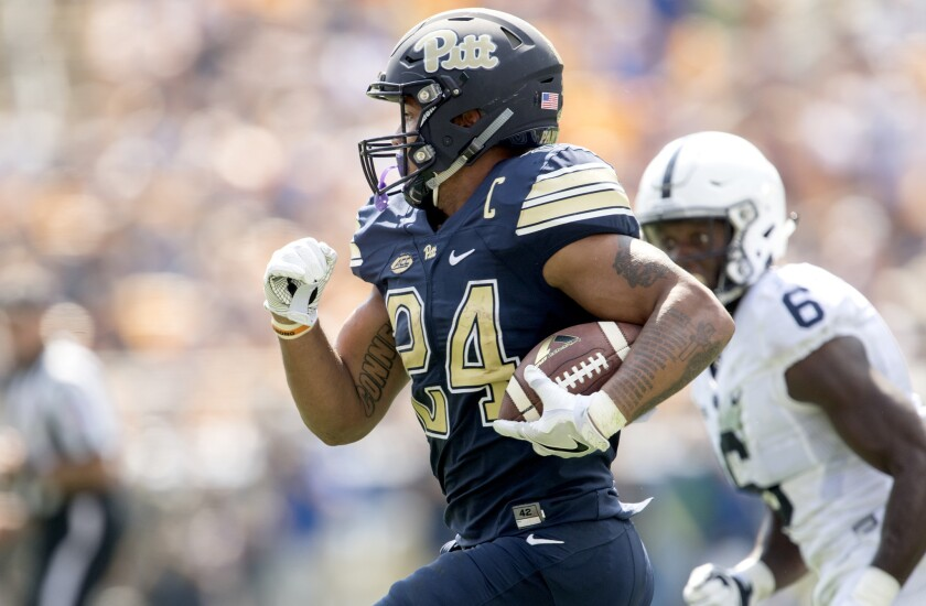 Pittsburgh running back James Conner picks up yardage against Penn State on Sept. 10.