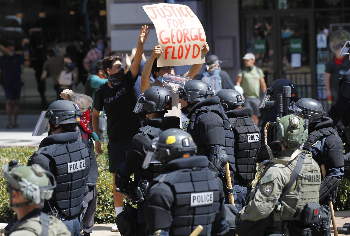 Protesters blocked streets in downtown San Diego as San Diego police armed in riot gear stopped them on May 31, 2020. The group was protesting the death of George Floyd.