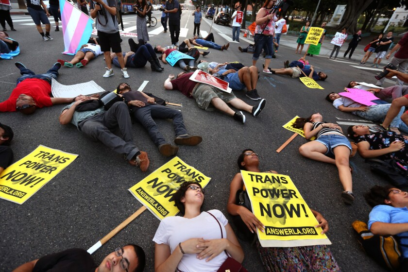 "LGBTQ activists and community leaders lie in the intersection of 1st and Main streets in Los Angeles in August to protest violence against transgender and ""gender-nonconforming"" people."
