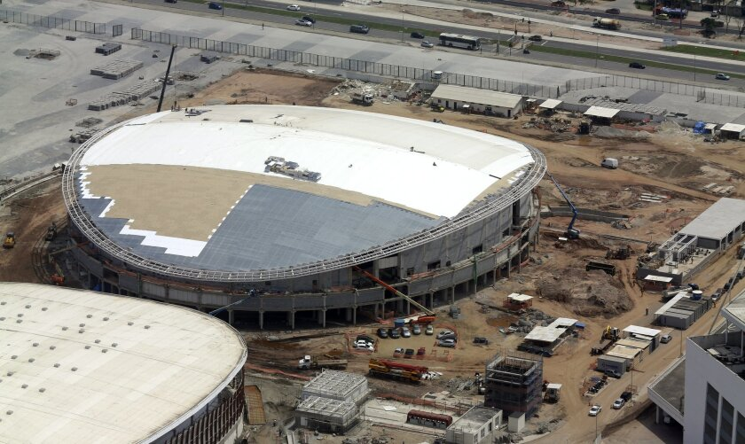"""FILE - In this Oct. 9, 2015, file aerial photo, construction continues at the Rio Olympics velodrome in Rio de Janeiro. The president of cycling's world governing body remains """"very, very concerned"""" that the velodrome under construction for the Rio Olympics will not be completed by the opening in A"""