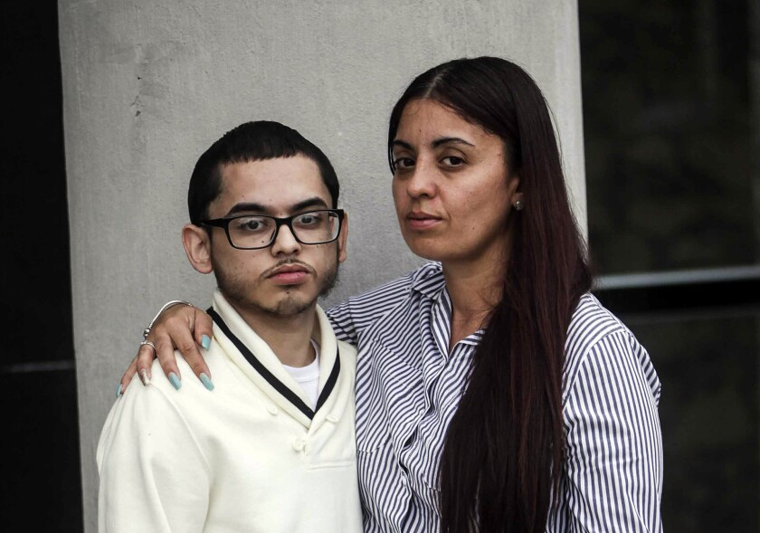 William Colon and his mother, Sonia Adorno, pose for a photograph outside of the Legal Aid Society's offices in Staten Island on October 4th. Colon was punched, Tased and arrested by NYPD officers who stormed into his apartment.