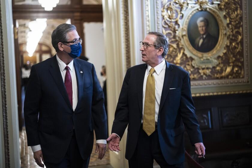 Bruce Castor and Michael van der Veen in a Capitol hallway.