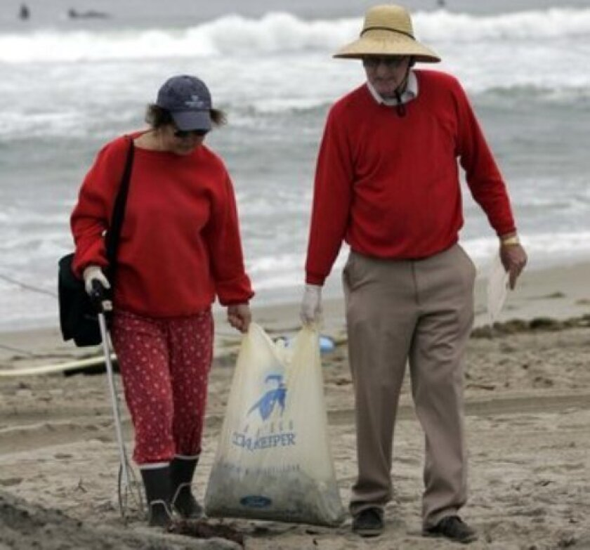 Beach garbage remains a problem on San Diego County beaches even though environmental groups regularly put out garbage cans and clean up after major holidays.