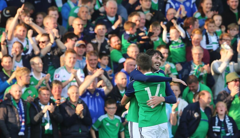 Northern Ireland's Kyle Lafferty, right, celebrates with Stuart Dallas after scoring against Belarus, his side's first goal during the international friendly soccer match Northern Ireland against Belarus at Windsor Park, Belfast, Ireland, Friday May 27, 2016. (Niall Carson  / PA via AP) UNITED KING