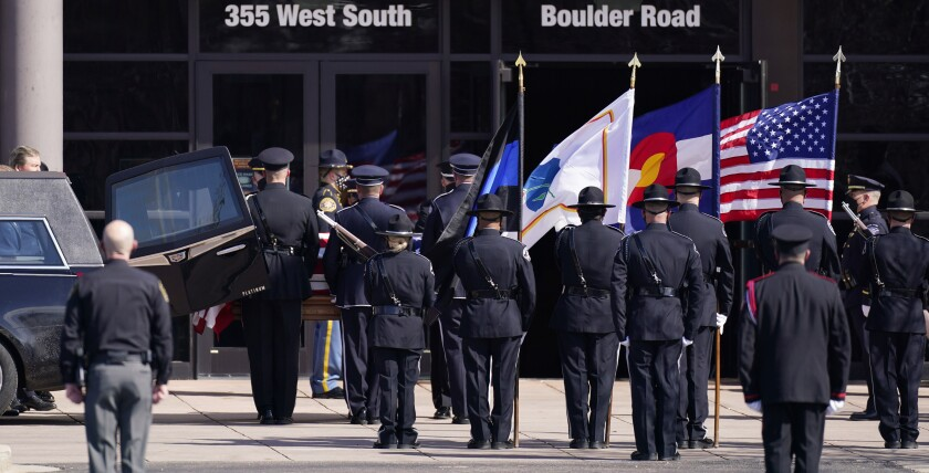 The honor guard unloads the casket to carry into a memorial service for fallen Police Department officer Eric Talley.
