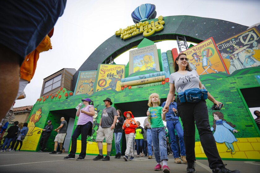 """Some of the first visitors to the San Diego County Fair enter the Del Mar Fairgrounds on opening day Friday. This year's """"Wizard of Oz""""-themed fair runs through July 4."""
