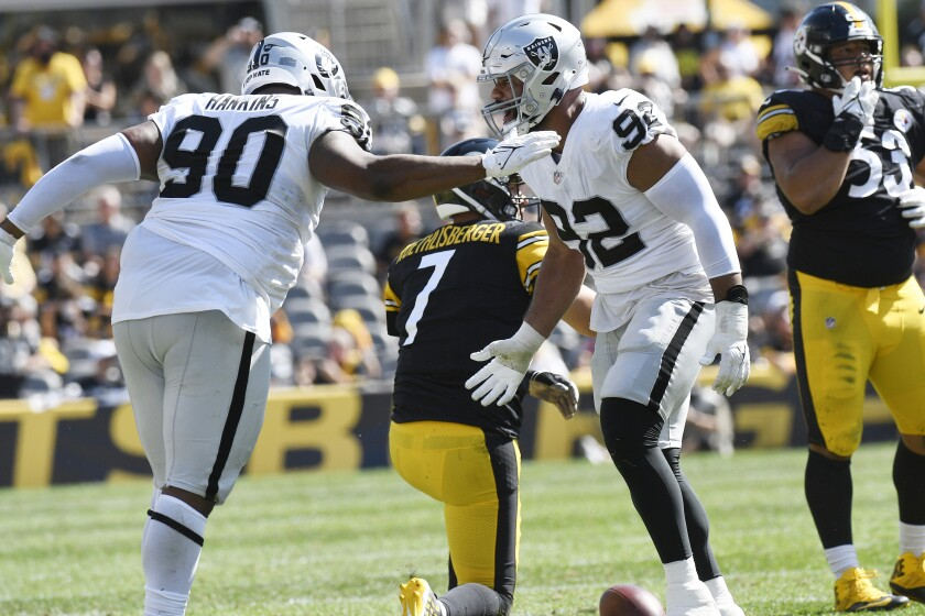 Las Vegas Raiders defensive end Solomon Thomas (92) and defensive tackle Johnathan Hankins (90) celebrate sacking Pittsburgh Steelers quarterback Ben Roethlisberger (7) during the second half of an NFL football game in Pittsburgh, Sunday, Sept. 19, 2021. (AP Photo/Don Wright)