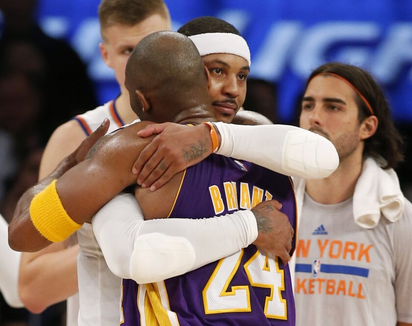 New York Knicks forward Carmelo Anthony (7) embraces Los Angeles Lakers forward Kobe Bryant (24) at the end of an NBA basketball game at Madison Square Garden in New York, Sunday, Nov. 8, 2015. The Knicks defeated the Lakers 99-95. (AP Photo/Kathy Willens)
