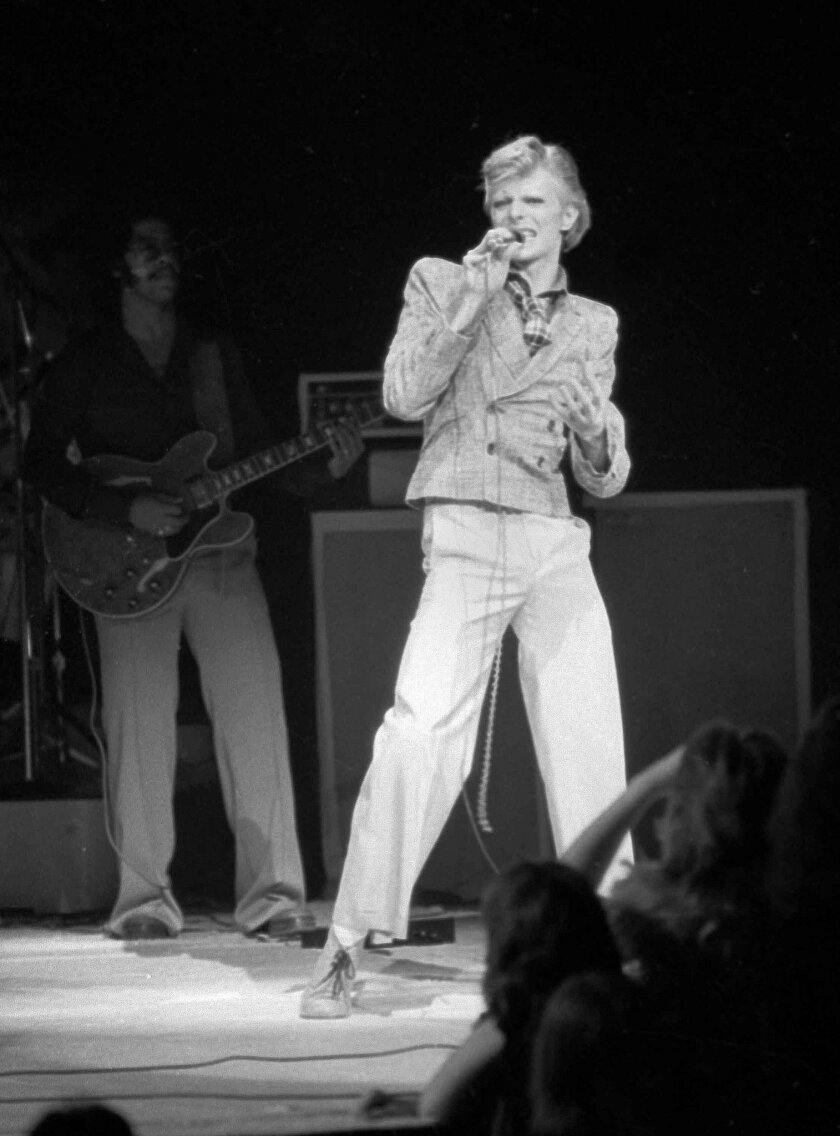 In this Nov. 1, 1974, file photo, David Bowie performs at Radio City Music Hall in New York. Bowie, the innovative and iconic singer whose illustrious career lasted five decades, died Sunday, Jan. 10, 2016, after battling cancer for 18 months. He was 69. (AP Photo/Suzanne Vlamis, File)