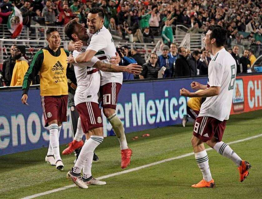 Miguel Layún of Mexico (2-L) is hugged by teammate, Marco Fabian (C) after Layun scored a goal against Iceland during the first half of their friendly soccer match at Levi's Stadium in Santa Clara, California, USA, 23 March 2018. EFE
