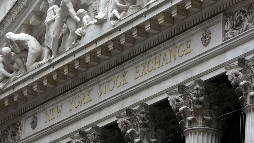 This Oct. 2, 2014, file photo shows the facade of the New York Stock Exchange.