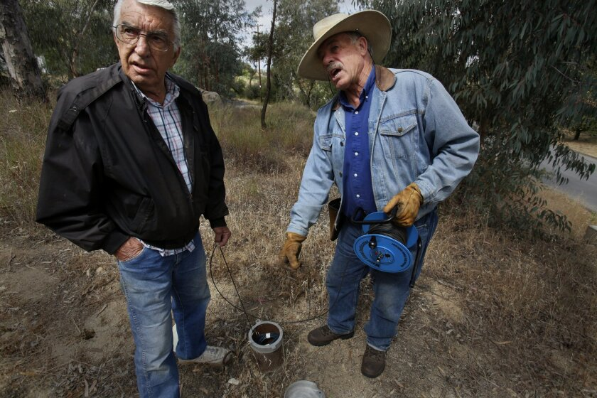 Poway residents Jerry Gill and Frank Vaplon test their private wells, and those of their neighbors, every Saturday. They are concerned about falling water levels, particularly for homes that rely only on wells.