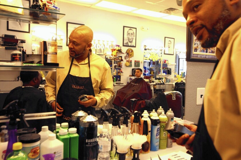 """Cornelius """"Cadillac"""" Burse now uses his skills as a barber at In Da Cut in Henderson, Nev."""