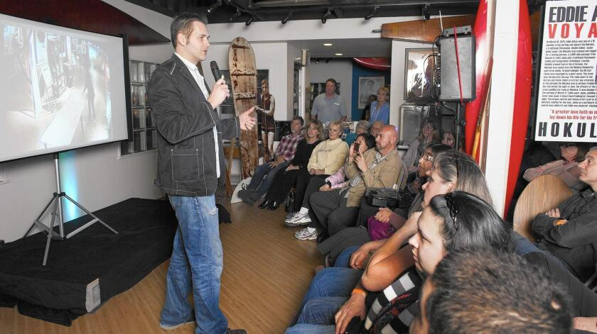 SyFy channel host and Huntington Beach resident Ben Hansen, pictured speaking Wednesday at the International Surfing Museum in Huntington Beach, is a former FBI agent turned paranormal investigator.