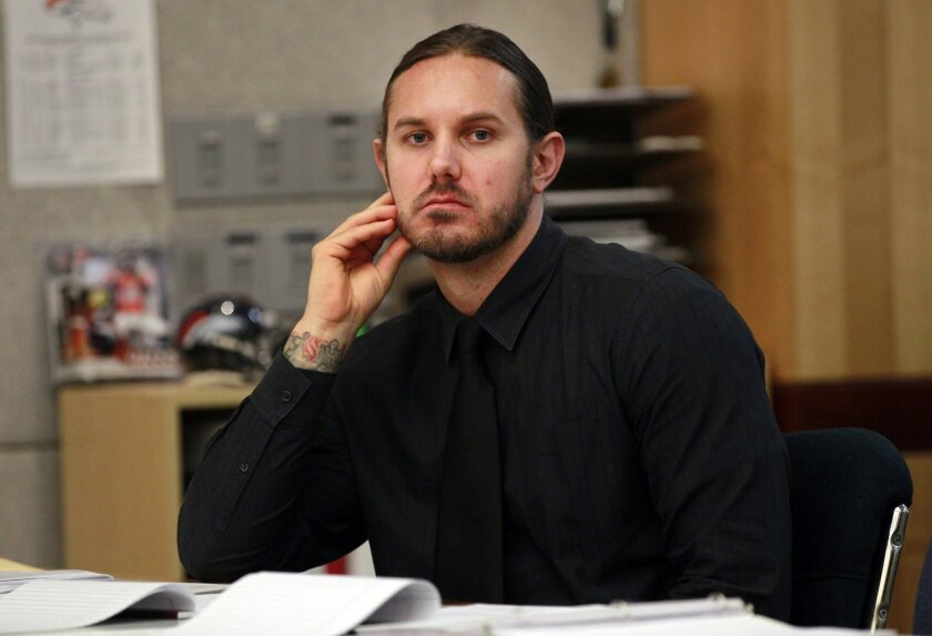 Timothy Lambesis, a co-founder of the Christian heavy metal band As I Lay Dying, faces a single count of solicitation for murder for a hit authorities say he put on his wife, shown here in Vista Superior Court.