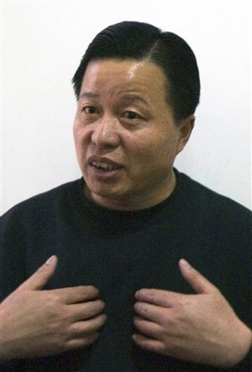 FILE - In this Feb. 24, 2006 file photo, Gao Zhisheng,  one of China's most daring lawyers,  gestures during an interview at a tea house in Beijing, China. Gao, a dissident Chinese lawyer who was missing for more than a year says he is now living in northern China and wants only to spend time with