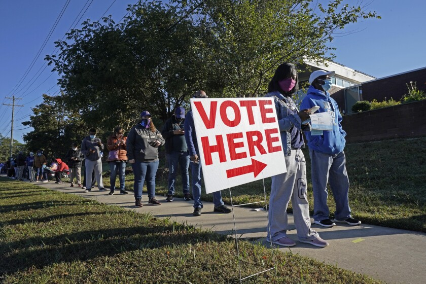 Early voters line up to cast 2020 ballots in Durham, N.C.