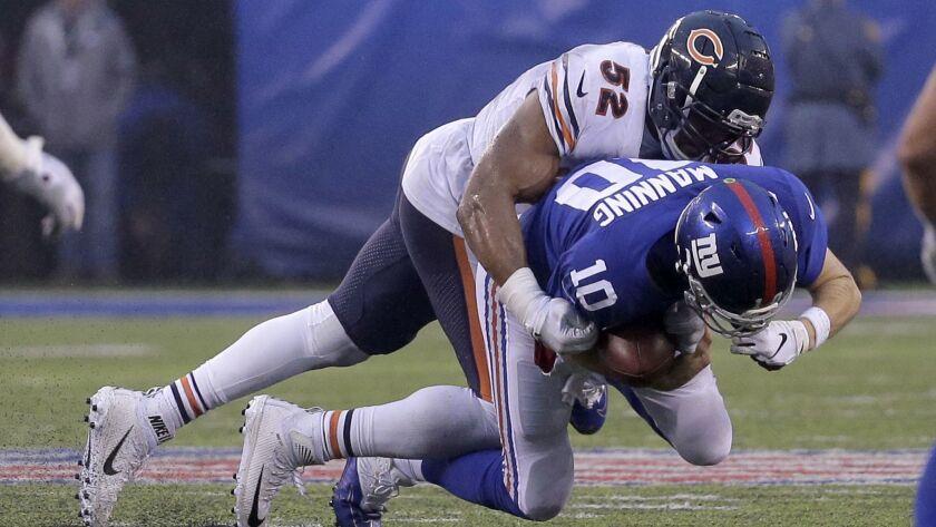 New York Giants quarterback Eli Manning (10) is sacked by Chicago Bears outside linebacker Khalil Ma