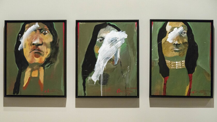 """On view in the Autry's """"Rick Bartow: Things You Know But Cannot Explain"""" are the acrylic-on-canvas works, from left: """"Bad Ass NDN1, for Dan Lomahaftewa,"""" """"Bad Ass NDN2, For Darren Vigil Gray"""" and """"Bad Ass NDN3, Nod to Fritz,"""" 2005."""