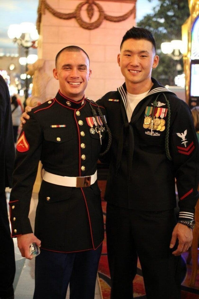 Petty Officer 2nd Class Jonathan Kong (right) and a squadmate from 1st Battalion, 5th Marine Regiment, Marshall Kotchasak. (USMC/released.)