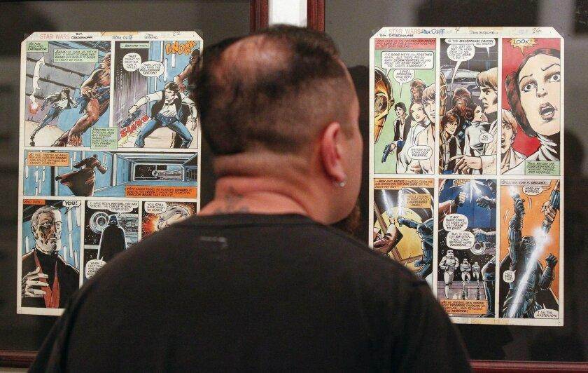 Junior Paden looks at Star Wars comic art at the San Diego Comic Art Gallery in San Diego.