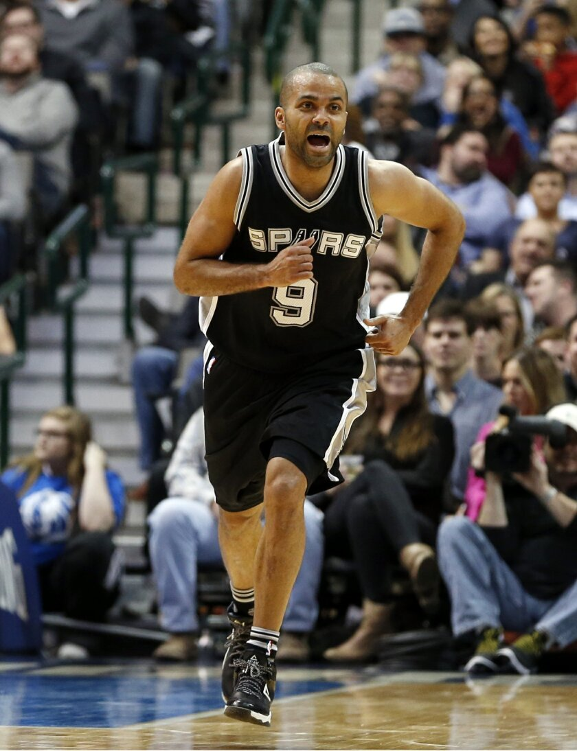 San Antonio Spurs guard Tony Parker celebrates a basket against the Dallas Mavericks during the first half of an NBA basketball game Friday, Feb. 5, 2016, in Dallas. (AP Photo/Jim Cowsert)