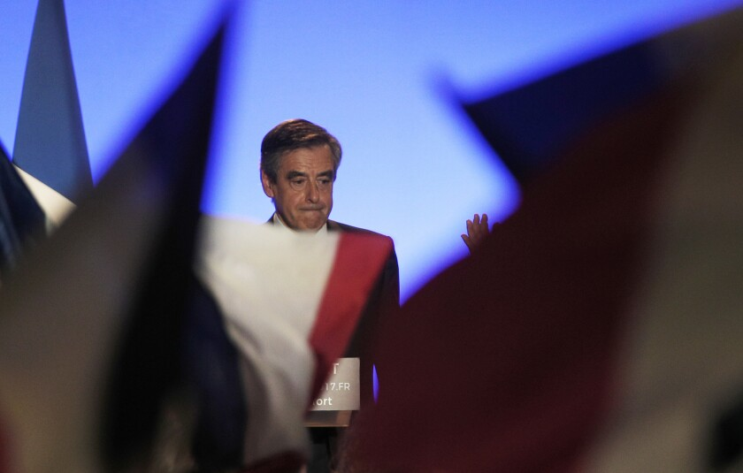 French conservative presidential candidate Francois Fillon delivers a speech during a campaign meeting in Maisons-Alfort, outside Paris, France, Friday, Feb. 24, 2017. The French financial prosecutor's office has decided to open a judicial inquiry into the allegedly fake parliamentary aide jobs that conservative presidential candidate Francois Fillon gave to his wife and two of his children.