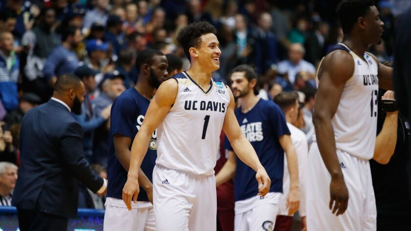DAYTON, OH - MARCH 15: Lawrence White #1 of the UC Davis Aggies reacts with teammates after defeati