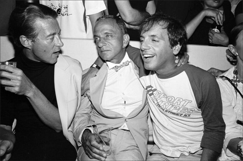 Halston, left, Roy Cohn and Steve Rubell