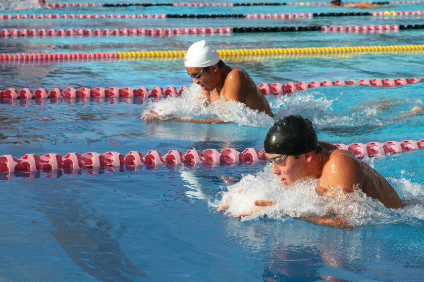 Bishop's freshman Michael Xu, left, and La Jolla's Parker Seale race to the finish in the 100-yard breaststroke April 22 at Coggan Family Aquatic Complex. Xu edged Seale at the wall, but the Vikings took overall wins in both the boys and girls competitions.
