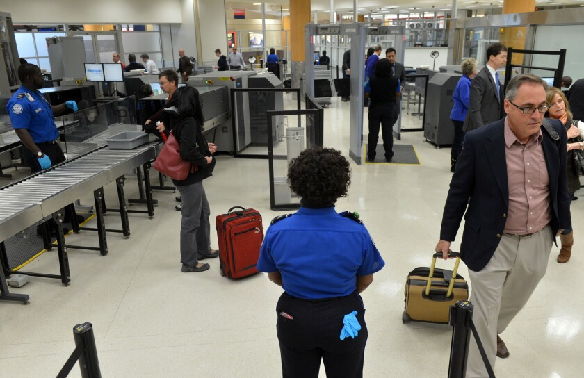 TSA agents work at a checkpoint for pre-cleared passengers at Hartsfield-Jackson Atlanta International Airport. The Department of Homeland Security is pushing private contractors for new technology to screen airline passengers.