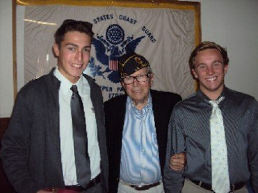 La Jolla High School seniors Adam Hersko-RonaTas (left) and Connor Hallman with Dr. Herman Froeb of La Jolla's American Legion Post 275. Courtesy