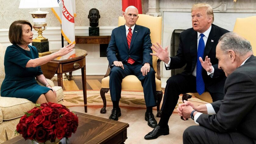 House Speaker Nancy Pelosi meets with Vice President Mike Pence, from left, President Trump and Senate Minority Leader Charles E. Schumer at the White House about the then-impending government shutdown on Dec. 11, 2018.