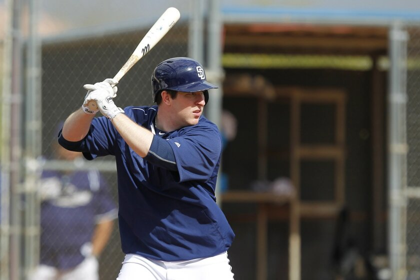 San Diego Padres Jedd Gyorko bats during a spring training practice.