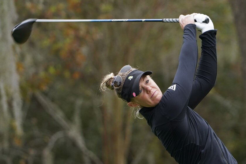 Amy Olson hits off the second tee during the third round of the U.S. Women's Open golf tournament, Saturday, Dec. 12, 2020, in Houston. (AP Photo/David J. Phillip)