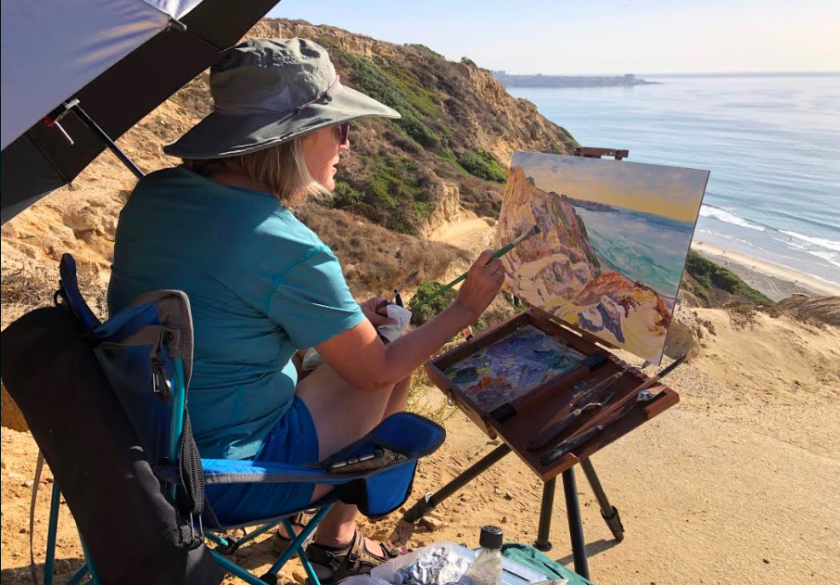 Heather Morgereth of La Jolla took advantage of the warm weather Friday to capture Blacks Beach on canvas