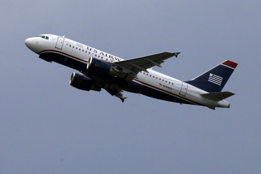 FILE - In this July 23, 2013, file photo, a US Airways jet takes off from Pittsburgh International Airport in Imperial, Pa. The last flight for US Airways will take place in fall 2015, and then one more name in airline history will disappear. American and US Airways merged in December 2013 and deci