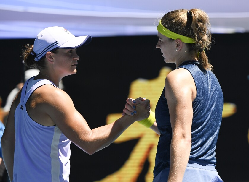 Ash Barty congratulates Karolina Muchova.