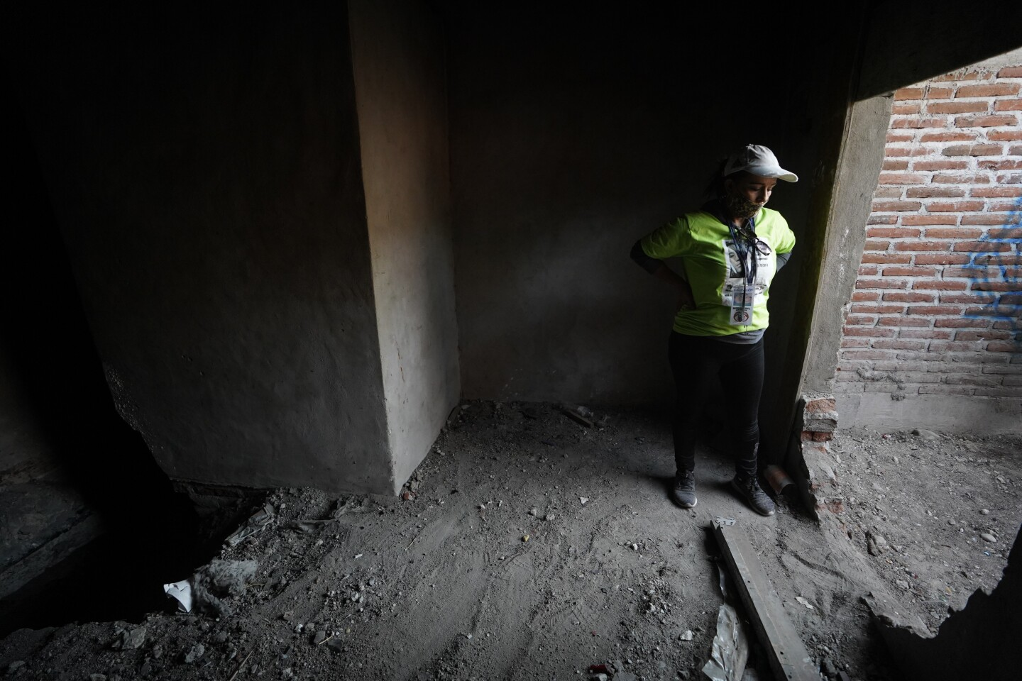 TIJUANA, BAJA CALIFORNIA - SEPTEMBER 12: Parents and family members who have formed collectives throughout Mexico help each other search for the remains of their missing children. Barbara Martinez stands inside the abandoned house where volunteers will soon begin to dig at Colonia Campos on Saturday, Sept. 12, 2020 in Tijuana, Baja California. (Alejandro Tamayo / The San Diego Union-Tribune)