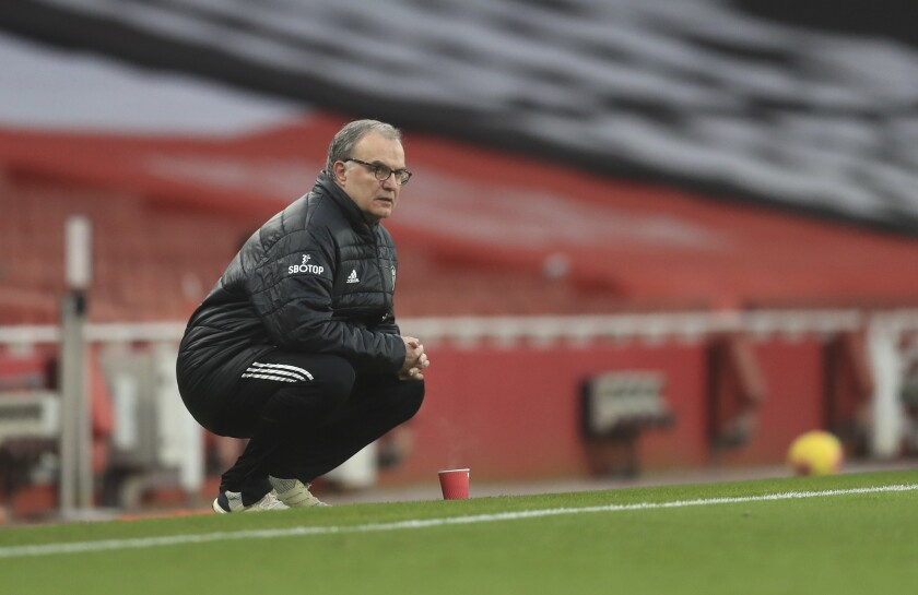 Leeds United's head coach Marcelo Bielsa follow the game during the English Premier League soccer match between Arsenal and Leeds United at the Emirates stadium in London, England, Sunday, Feb. 14, 2021. (Adam Davy/Pool via AP)