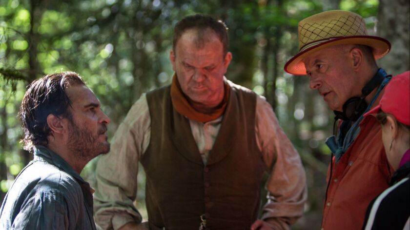 (L to R) Actor Joaquin Phoenix, actor John C. Reilly and director Jacques Audiard on the set of THE