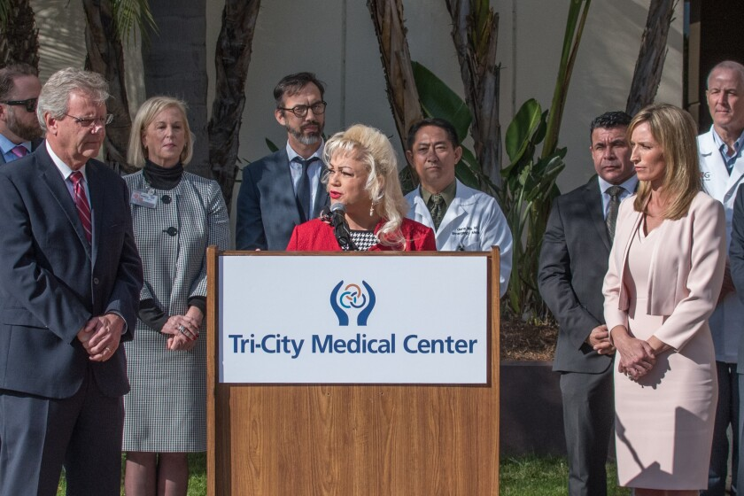 Tri-City Medical Center board chair Leigh Anne Grass announces a joint agreement Monday morning that, if fully approved, will build a 16-bed $17 million behavioral health unit at the Oceanside hospital within two to three years. Grass is surrounded by county and hospital officials including county supervisors Jim Desmond (far left) and Kristin Gaspar (far right).