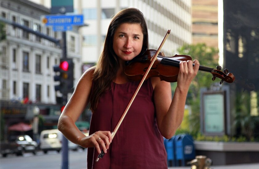 Violinist Kate Hatmaker is the co-founder and director of Art of Elan.