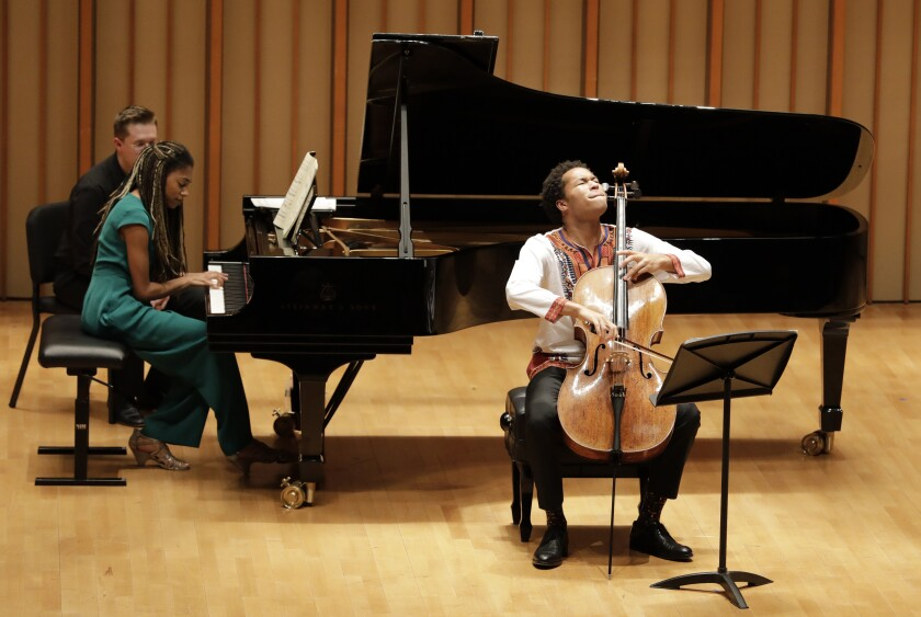 Sheku Kanneh-Mason plays cello with his sister Isata Kanneh-Mason on piano Tuesday at the Colburn School in L.A.
