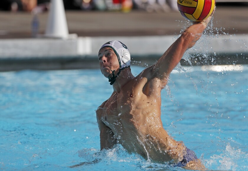 Costa Mesa High's Caedmon Fisher fires a shot during the first half against Estancia in an Orange Co