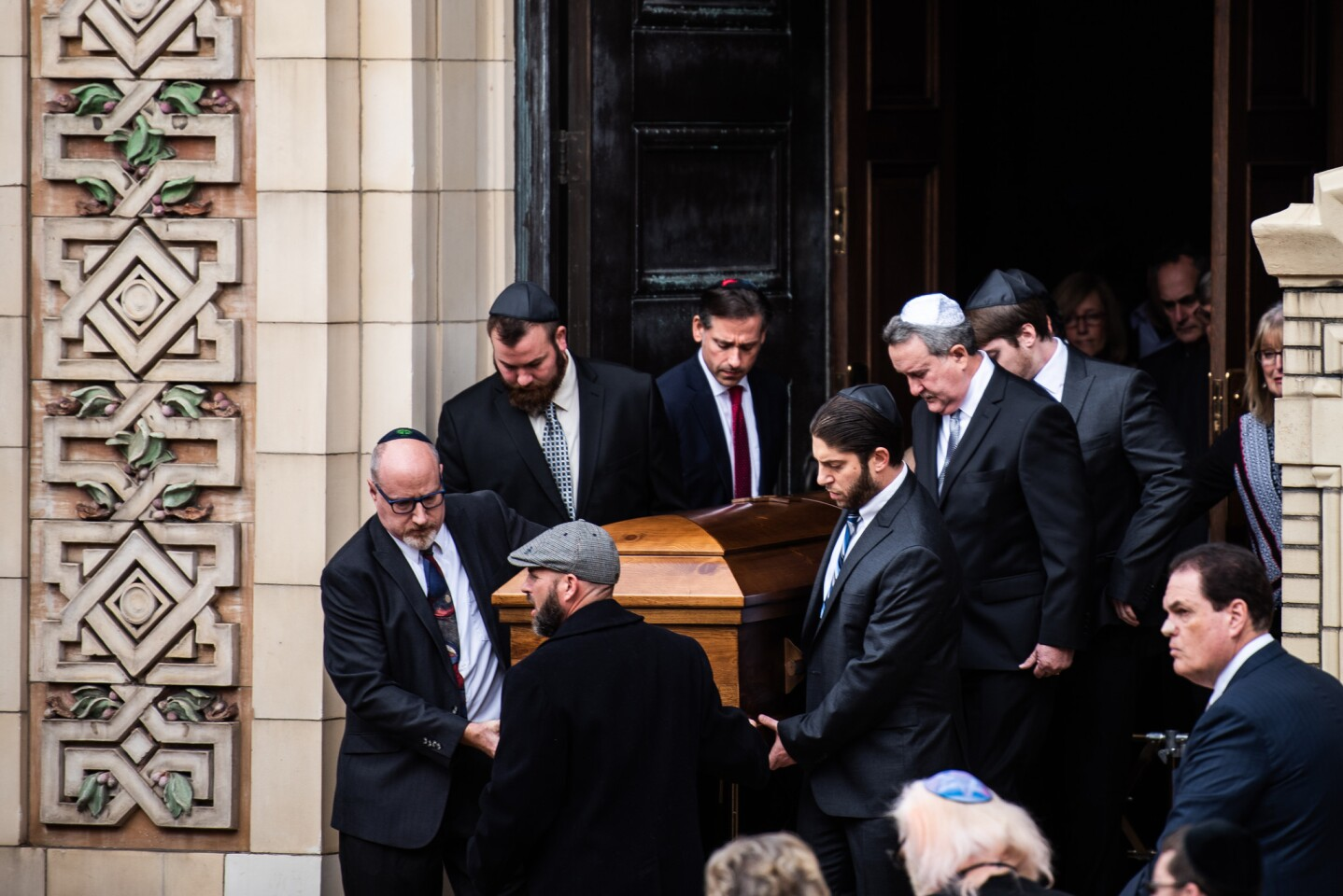 Pallbearers carry the caskets of brothers David and Cecil Rosenthal in Pittsburgh on Tuesday.