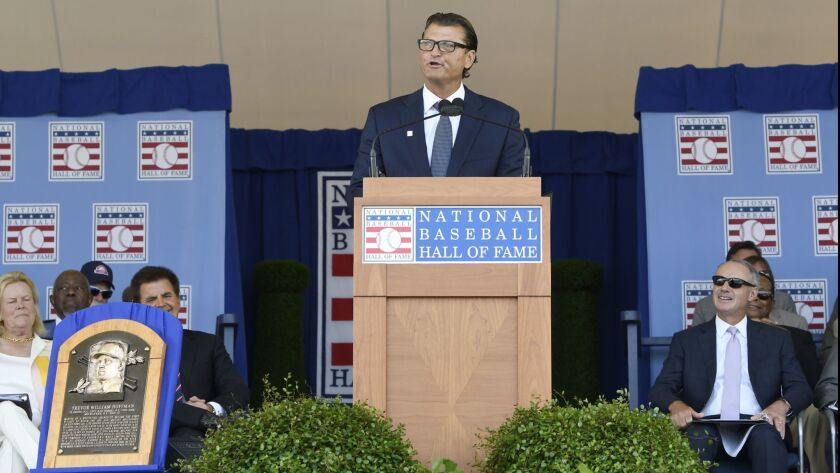 National Baseball Hall of Fame inductee Trevor Hoffman, center, speaks during an induction ceremony