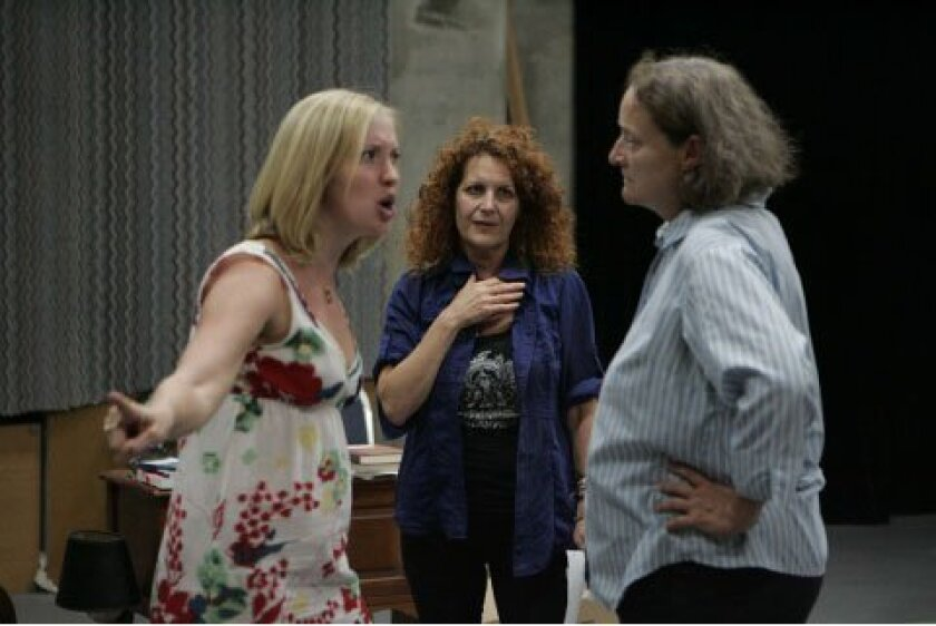 """Kim Rubinstein (center) directs a confrontation between Melissa (Kimberly Parker Green, left)  and Mary (Nancy Robinette) in rehearsals for """"The Savannah Disputation,"""" the Old Globe Theatre's comic saga of religious rancor."""