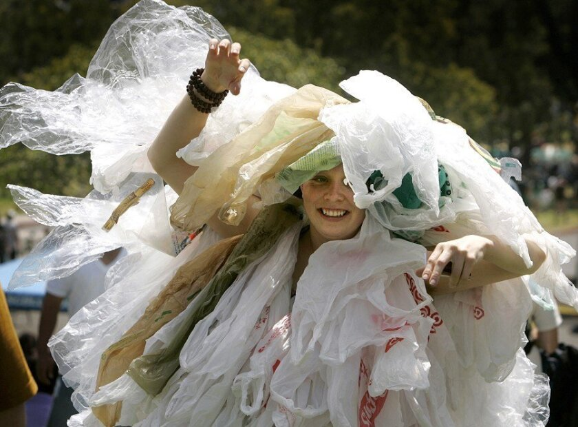 Anna Miller of Grant Hill dons more than 100 plastic bags to become the Plastic Bag Monster during EarthFair at Balboa Park on Sunday, calling attention to bags ending up in the ocean, where they can kill sea life.